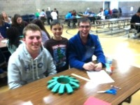 3rd graders make Christmas wreaths with their senior buddies